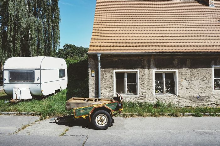 """In Germany we call this """"Ostalgie"""". Old things from East Germany (GDR) that were produced before 1990. Here is an original caravan and trailer from this period Caravan Trailer Ostalgie Nostalgia Old House GDR East Germany From East Germany With Love Street Streetphotography"""