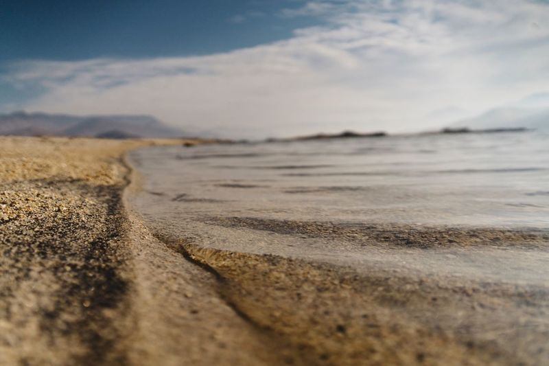 Beach Sand Nature Sea Shore Scenics Outdoors Surface Level Beauty In Nature Selective Focus Water Sky Tranquility Tranquil Scene Day No People Wave Landscape Horizon Over Water Sand Dune Low Angle View