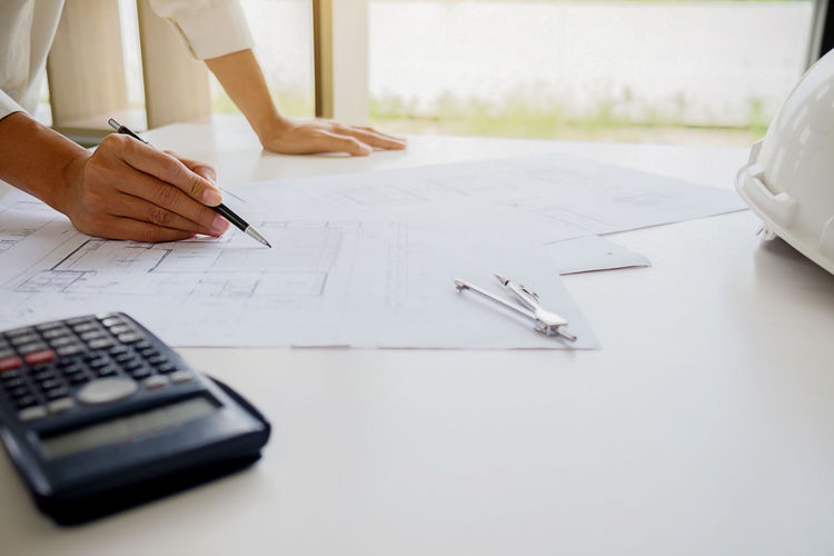 Midsection of architect working in office