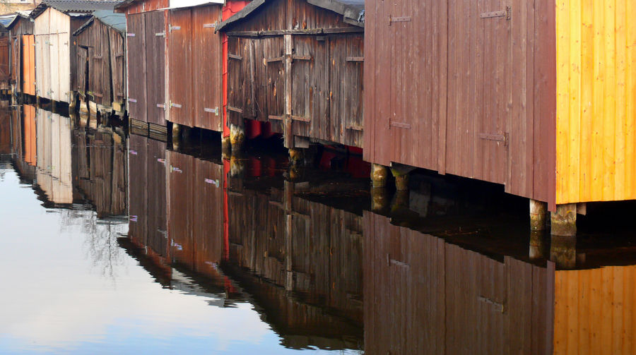 EyeEmNewHere Animal Animal Themes Architecture Building Building Exterior Built Structure Day House Lake Nature No People Outdoors Post Reflection Water Waterfront Wood - Material Wooden Post