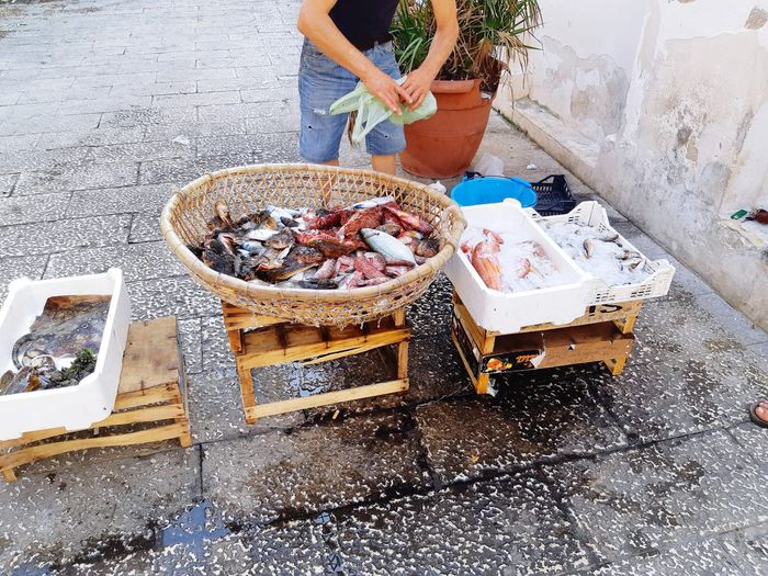 High angle view of man preparing fish on grill