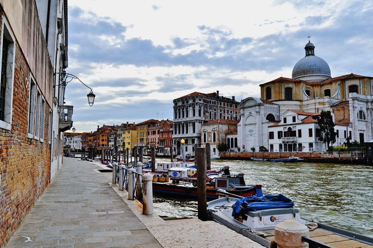 Boats moored on grand canal against sky