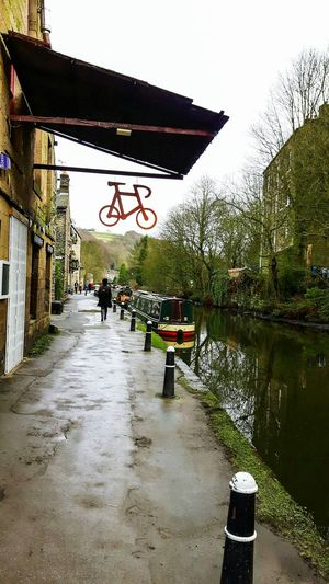 A muddy canal towpath in Hebden Bridge Canal Towpath Hebden Bridge Yorkshire Bike