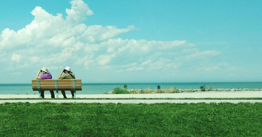 Leisure Activity Beach Bench Relaxation Tranquility Tranquil Scene Full Length Scenics Togetherness Horizon Over Water Cloud - Sky Blue Couple Birdwatching Birdwatchers CuteCouple?? Person Sky Water Greatlakes People In Places Landscape