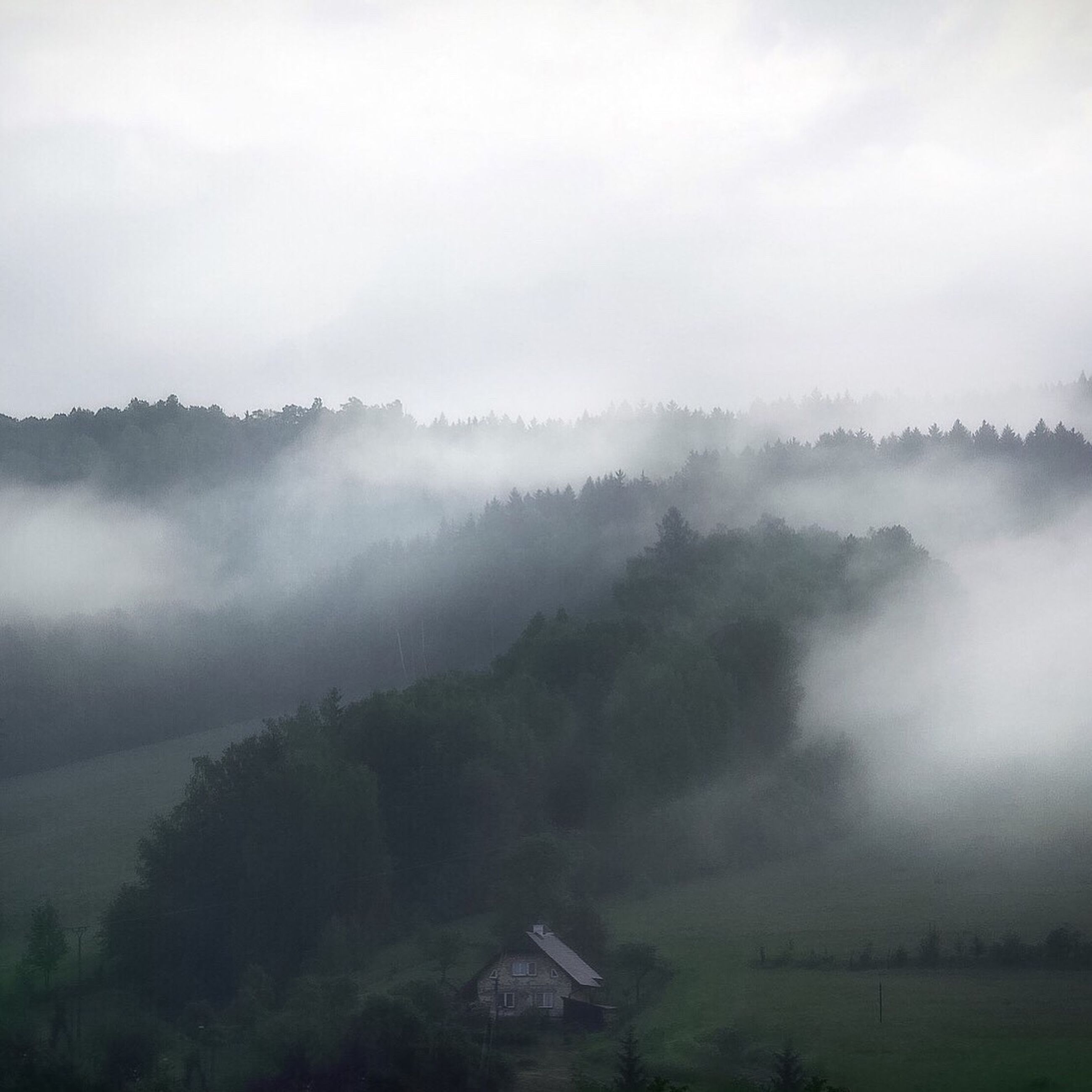 fog, foggy, house, scenics, built structure, tranquil scene, tranquility, architecture, weather, beauty in nature, building exterior, tree, mountain, nature, sky, idyllic, mist, non-urban scene, cloud - sky, growth, outdoors, day, remote, majestic, mountain range, rural scene, misty, no people