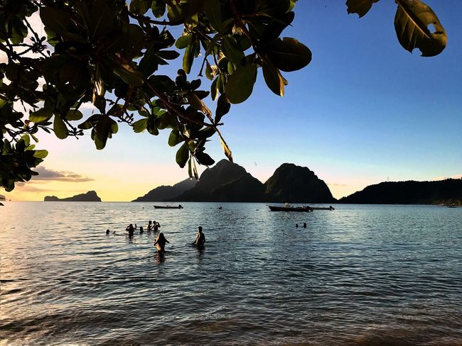 Beckoning.... Water Nature Sea Scenics Beauty In Nature Outdoors Mountain Tree Tranquil Scene Sky Tranquility Sunset Leisure Activity Real People Day Men Togetherness People Eyeem Philippines Life Is A Beach Beach Beachphotography EyeEm Nature Lover EyeEm Gallery El Nido