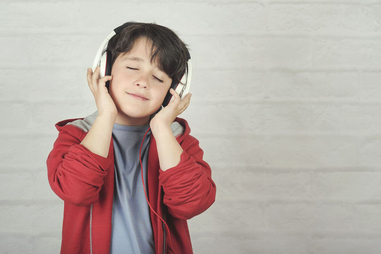 Child Boy Sing Accessory Headphones Music Audio Song Listen Hear Melody Sound Happy People Singer  Happiness Earphones Microphone Voice Performance Concert Karaoke Show Concept Portrait Emotion Record Joy Funny Fun Talent Star Expression Lifestyle Feeling Kid Childhood Standing Leisure Activity Innocence