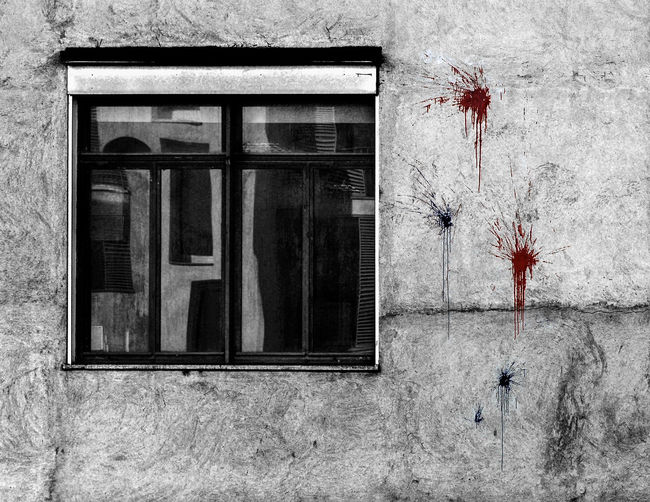 The wall of a residential home in Torino, Italy, vandalized with red and blue paint thrown at it Paint Reflection Relaxing Torino Blue Building Exterior Conceptual Italy No People Red Paint Turin Vandalism Vandalized Window Windows