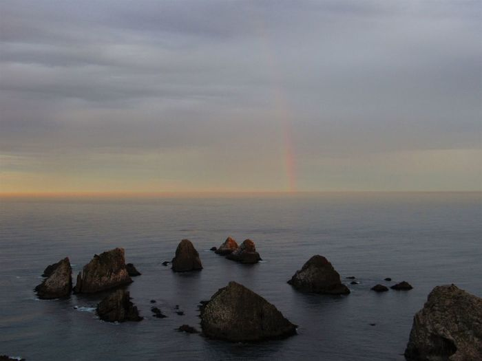 EyeEmNewHere Nugget Point Treasure At The End Of The Rainbow Beauty In Nature Dusk Horizon Over Water Idyllic Nature New Zealand Outdoors Rainbow Rock - Object Scenery Scenics Sea Sky Tranquil Scene Tranquility Water