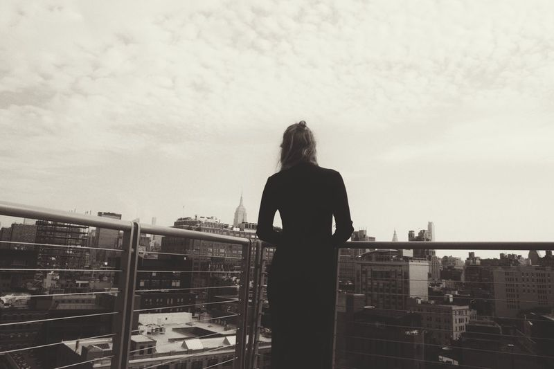 Standing Rear View Railing City Tourist Looking At View Sky Vacations Tourism Casual Clothing Person Long Hair Cloud - Sky Day City Life Carefree Go Higher