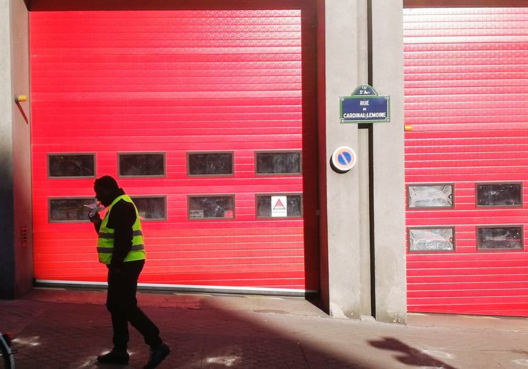 Minimalism City Life Urban Scene Full Length Red Occupational Safety And Health Doorway Standing Protection Door City Safety Window Fire Alarm Closed Emergency Equipment Gate Firefighter Rescue Worker EyeEmNewHere