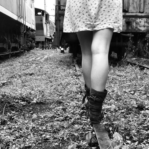 Low Section Of Woman Standing On Railroad Track