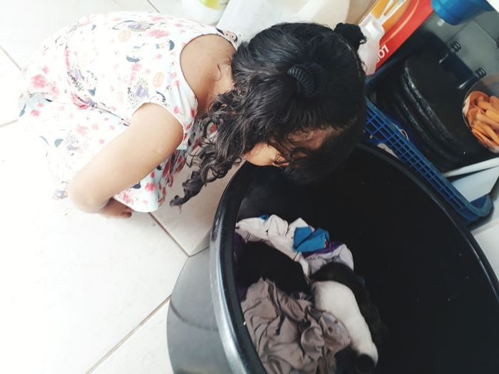 High Angle View Of Girl Looking In Tub At Home