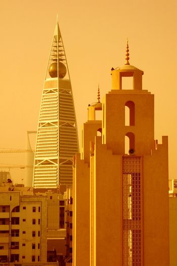Sunset Tower Architecture No People City Skyscraper Orange Color Sand Dust In The Wind Dusty Ryadh Riad Saudi Arabia Paint The Town Yellow