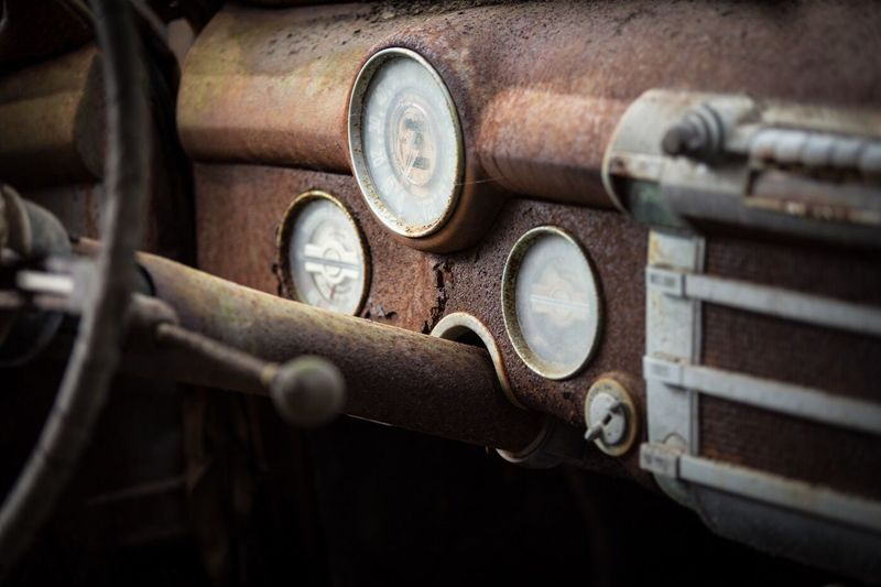 Close-up of abandoned car dashboard