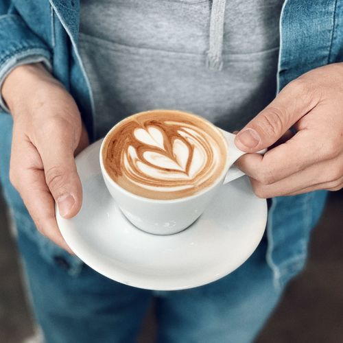 Coffee - Drink Food And Drink Coffee Coffee Cup Drink Mug Refreshment Cup Cappuccino Frothy Drink Hot Drink Midsection Froth Art Holding Adult One Person Latte Human Hand Indoors  Hand
