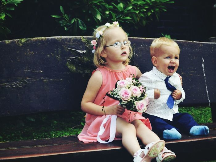 Cute Baby Girl And Baby Boy  Sitting Outdoors