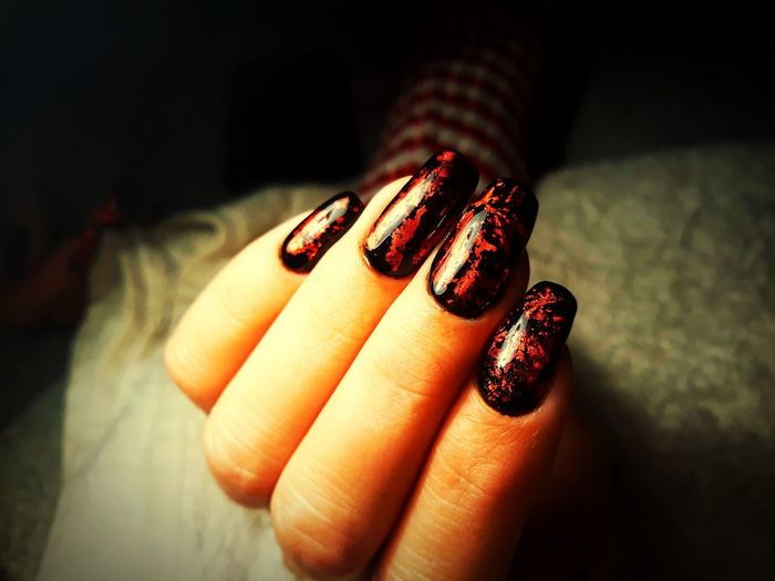 Cropped Hands Of Woman With Nail Art