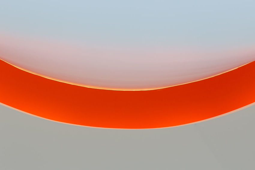 Abstract Backgrounds Blank Circle Close-up Copy Space Curve Geometric Shape Indoors  Light - Natural Phenomenon Minimalism No People Orange Color Pattern Red Reflection Shape Simplicity Single Object Studio Shot Vibrant Color