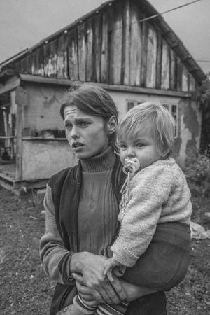 """""""In Exile"""" is a documentary portrait series of Molokans. Molokans are a Spiritual Christian religious group of Russian origin rejected more than two hundred years ago by Orthodox Church and exiled in the country of Georgia. They live in the east part of Georgia in the village of Ulianovka. After the collapse of the Soviet Union, many of them came back to Russia; also, their young generation left there to find a better job and lifestyle opportunity in the other parts of Georgia, and just a few of them(around 10 families) still live in this small territory. A small and old community which will be forgotten forever. Human Face Documentary Storytelling Blackandwhite Monochrome Portrait Photography Places Village Travel Real People Real Person person Daily Life Two Female Life Style Looking Journalism Photojournalism Documentary Photography History Pain Child Childhood Togetherness Girls Bonding Love Human Representation The Photojournalist - 2018 EyeEm Awards The Portraitist - 2018 EyeEm Awards The Traveler - 2018 EyeEm Awards"""