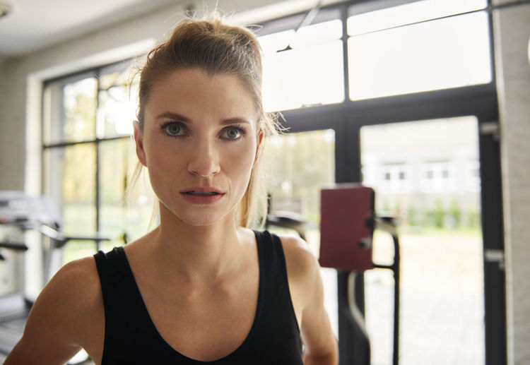 Close-up portrait of young woman in gym