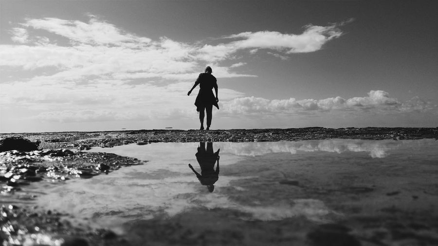Silhouette of person walking on beach
