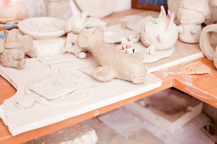High angle view of figurine on table
