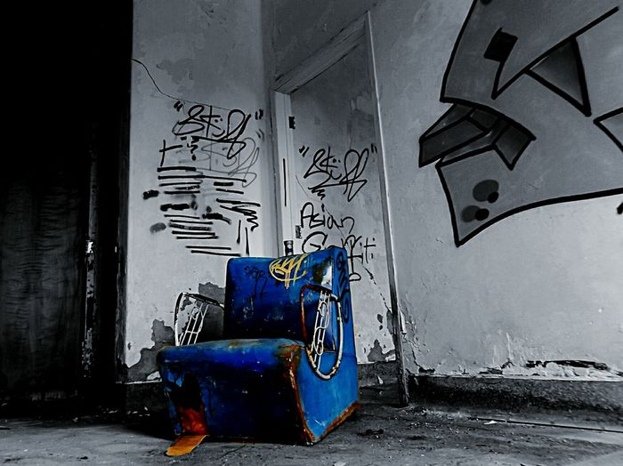 Odd chair. Chair Is This Seat Taken? Grafitti Odd Color Splash EyeEm_abandonment Sofa Old Buildings Every Picture Tells A Story Vintage