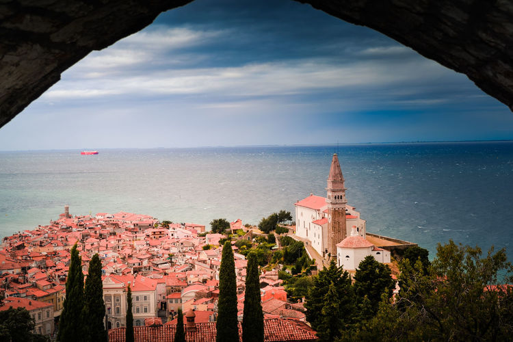 View of Pirano Sea Architecture Sky Built Structure Water Horizon Over Water Tree Building Exterior Horizon Nature Building Cloud - Sky Plant No People Day History Travel Destinations The Past Land Outdoors Piran Slovenia Pirano Fisherman Town