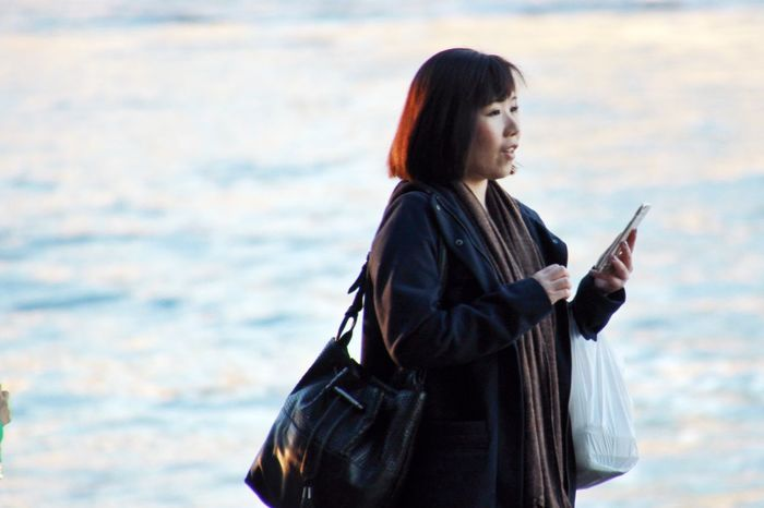 Walk and talk Three Quarter Length Standing Casual Clothing Day Outdoors Asian  Talking Mobile Love Mobile Phone Technology Technology Everywhere People Woman People Photography Street Streetphotography Street Photography Holding EyeEmAustralia Australia Internet Addiction People And Places Mobile Conversations Women Around The World