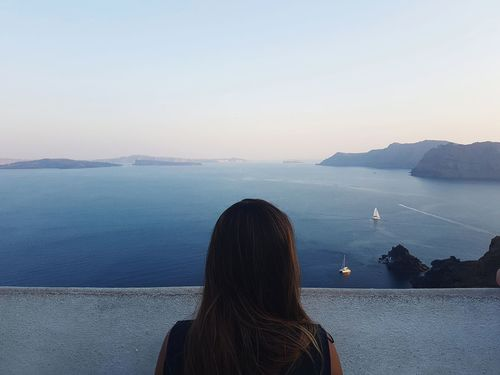 Santorini, Greece Rear View One Woman Only Only Women Adults Only Water Lake Women Adult One Person Mountain People Tranquility Day One Young Woman Only Outdoors Scenics Nature Sky Young Adult Landscape Nature Greece Santorini View Oia Santorini The Week On EyeEm An Eye For Travel