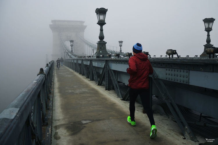 #budapest #ChainBridge #mistymorning #Morning #motivation #reportage #runner Bridge - Man Made Structure City Day Fog Full Length Men One Man Only One Person Only Men Outdoors People Real People Travel Destinations