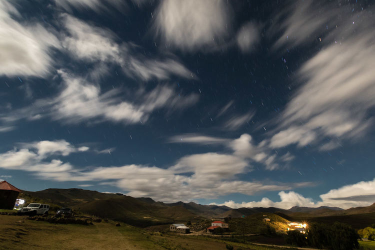 Scenic View Of Houses By Mountains Against Sky