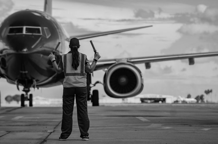 Airplane Travel Occupation Outdoors Real People Commercial Airplane Standing Transportation Day Inthemoment Enjoying The Moment Photographyislifee EyeEmNewHere Photojournalism Photographylovers Canonphotography Canonrebelt5 Enjoying Life Rgv Focus On Foreground Airfield Rear View Swalife Southwest  Blackandwhite
