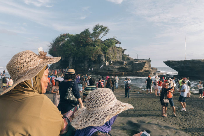 Tanah Lot bali Bali Bali, Indonesia Beach Day Large Group Of People Leisure Activity Lifestyles Men Nature Outdoors People Real People Sky Temple Vacations Women Been There. Connected By Travel