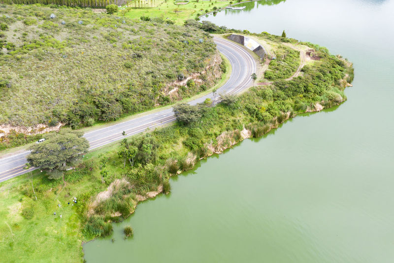 Water High Angle View Plant Nature Day Road Green Color Beauty In Nature Transportation No People Tranquility Scenics - Nature Tranquil Scene Outdoors Land Lake Curve Tree Non-urban Scene Road Highway Carretera