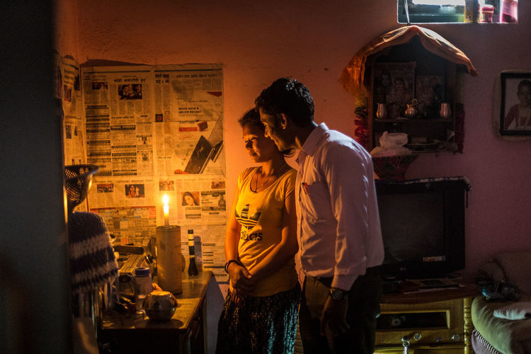 Jilhu and his wife in their 13-square meter room in Kathmandu,Nepal. Jilhu works as a hotel manager and earns 250$ a month The Portraitist - 2016 EyeEm Awards The Photojournalist - 2016 EyeEm Awards Nepal Portrait Lowlightphotography