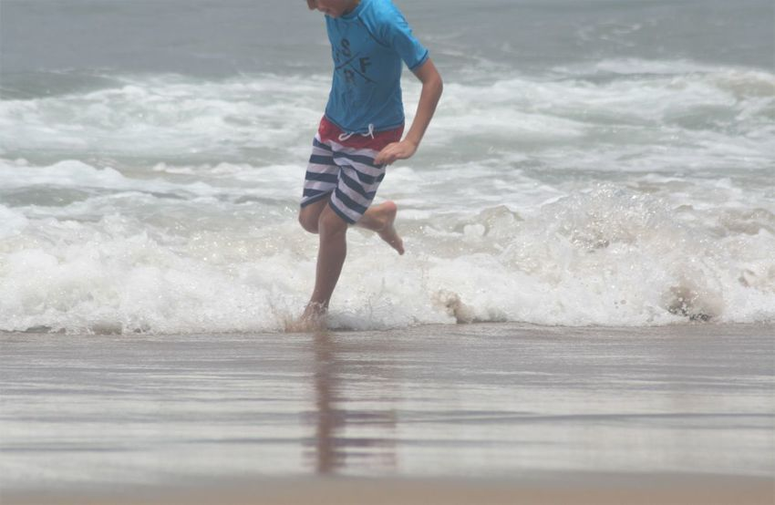 Fun Holiday Ankle Deep In Water Beach Beauty In Nature Childhood KwaZulu-Natal Coast Leisure Activity Low Section Motion Nature One Person Outdoors People Real People Sand Sea Umbrellas Vacations Water