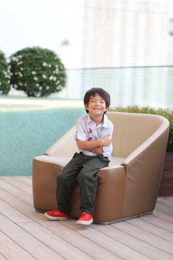 Portrait of smiling boy sitting on floor