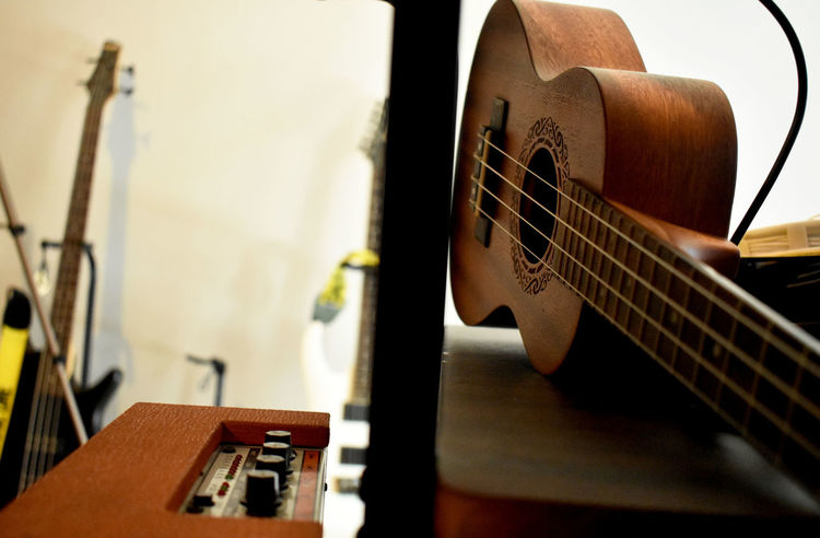 Strings Adjust Arts Culture And Entertainment Classical Guitar Close-up Day Divide Electric Guitar Guitar Indoors  Music Musical Equipment Musical Instrument Musical Instrument String No People Orange Amps Ukulele