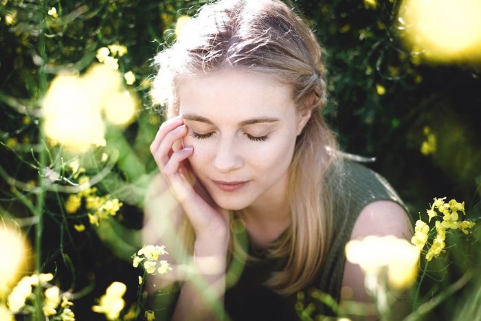 Blond Hair One Person Young Adult Front View Outdoors Young Women Flower Day Looking Down Eyes Closed  Nature Beautiful Woman Plant Headshot Focus On Foreground Sunlight One Young Woman Only One Woman Only Close-up Real People The Portraitist - 2017 EyeEm Awards