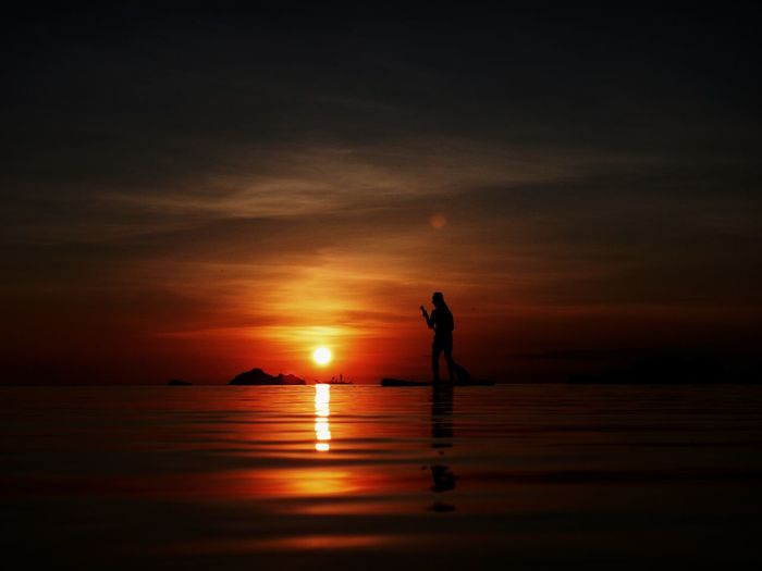 Sailing to the sunset of Tablas point Sunset Reflection Two People Sea Silhouette Horizon Over Water Beach Outdoors Night Sky Water Full Length Vacations Nature People Men Travel Destinations Adult Fisherman Beauty In Nature Only Men Miles Away Standing Beauty In Nature Silhouette