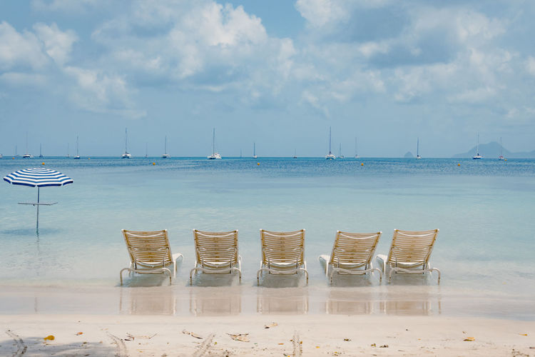 Caribean Sea Deck Chair Sunny Beach Beauty In Nature Caribbean Chair Day Horizon Horizon Over Water Invitation To Relax Island Land Nature No People Paradise Peaceful Scenics - Nature Sea Sky Tranquil Scene Tranquility Transat Tropical Climate Water