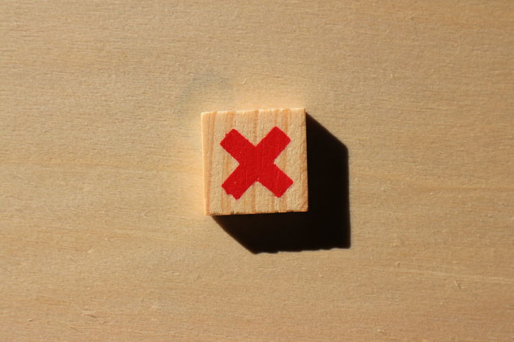 Close-up of multiplication sign on wood