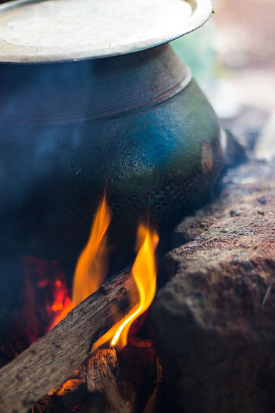 Fire Cooking in a Mud pot Cooking Burning Close-up Day Fire Cooking Flame Heat - Temperature Mud Pot No People Oldage Outdoors Vintage