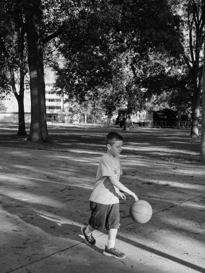 Visual Journal June 2017 Fairbury, Nebraska A Day In The Life Americans B&w Basketball Camera Work Casual Clothing Childhood Dribbling Everyday Lives EyeEm Best Shots FUJIFILM X-T1 Fujinon 10-24mm F4 Full Length Kids Being Kids Kids Playing Light And Shadow One Boy Only One Person Outdoors Photo Diary Playing Real People Rural America Small Town Visual Journal