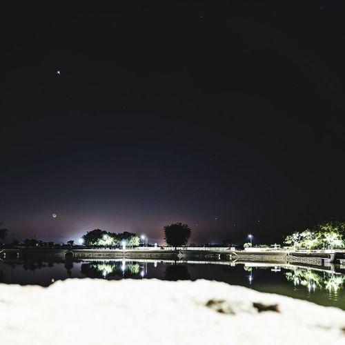Illuminated bridge against sky at night during winter