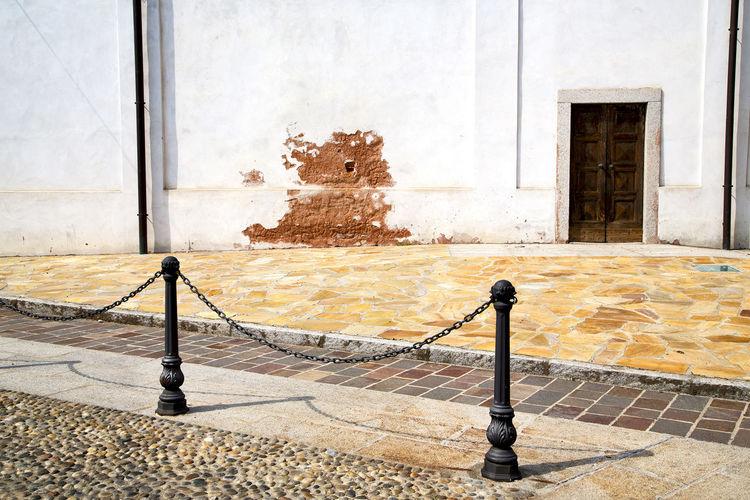 Closed door of building with sidewalk in front