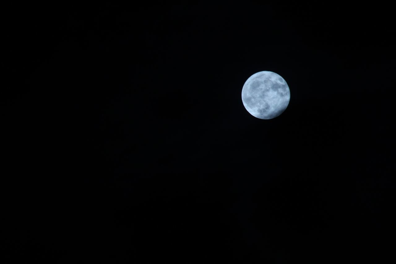 moon, astronomy, copy space, night, moon surface, nature, planetary moon, beauty in nature, tranquility, scenics, tranquil scene, no people, space exploration, low angle view, outdoors, half moon, clear sky, space, sky