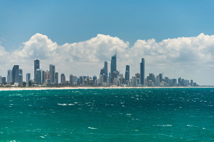Gold Coast cityscape and Surfers Paradise beach on sunny day Gold Coast Australia Skyline Surfers Paradise Beauty In Nature Tourism Destination Travel Beach Real Estate Architecture City Waterfront Urban Skyline Office Building Exterior Sea Skyscraper Water Landscape Tall - High Cityscape Outdoors No People Modern Resort